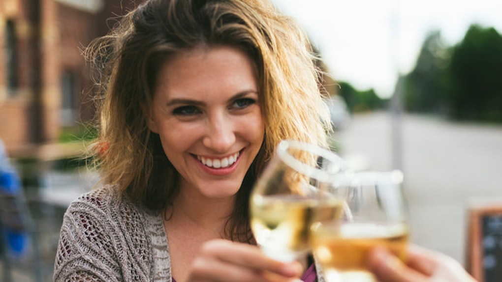 cheers woman drinking wine