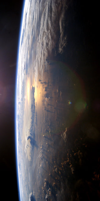 From the International Space Station program and the JSC Earth Science & Remote Sensing Unit, ARES Division, Exploration Integration Science Directorate. ISS007-E-10807 (21 July 2003) - This view of Earth's horizon as the sunsets over the Pacific Ocean was taken by an Expedition 7 crewmember onboard the International Space Station (ISS).