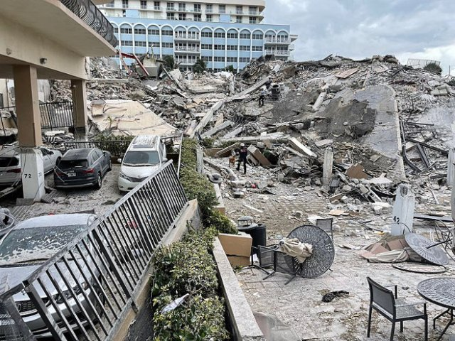 Surfside Condominium: a human and canine search and rescue team.