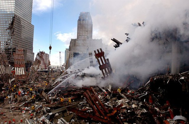 Photo of World Trade Center rubble and fires, by U.S. Navy Photographer's Mate 2nd Class Jim Watson. (September 14, 2001)