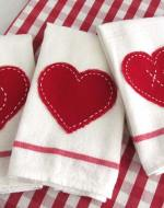 """Saying """"I love you!"""" doesn't have to cost a bundle this Valentine's Day. Impress your guests with this adorable little tea towel {Pottery Barn inspired} for only $0.79! Read the easy tutorial with free printable pattern at BrenDid.com. The easy craft uses premade flour sack towels and iron-on adhesive. The best part, at under $1 each you can afford to spread the Valentine love around the whole neighborhood! - See more at: http://brendid.com/pb-inspired-valentine-tea-towels/"""