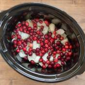 Easy slow cooker recipe. Boneless pork chops or pork ribs simmer with cranberries, onion and apples to create a delicious dish flavored with balsamic vinegar. Healthy crock pot recipe.