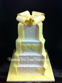 yellow bow and ribbon cake