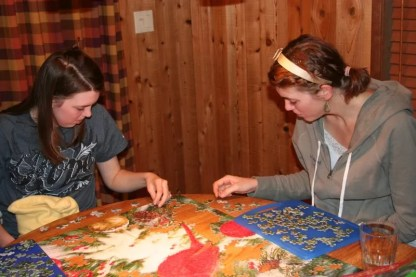 Melissa and Ashley work on the puzzle