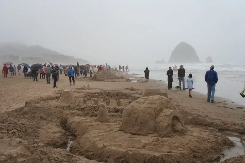 Sandcastles at Cannon Beach with Haystack Rock in the distance