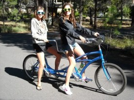 Ashley and Heather model their shades on a rented tandem bike