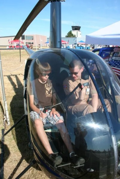 Jamison being shown the inside of a helicopter trainer
