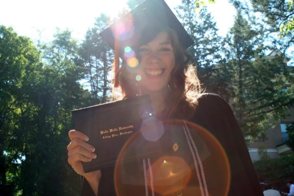 Ashley shows off her diploma