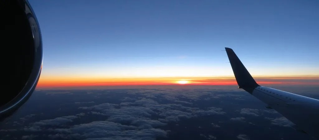 Engine, sunset and wing