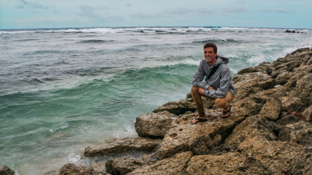 Jamison on rocks by the sea