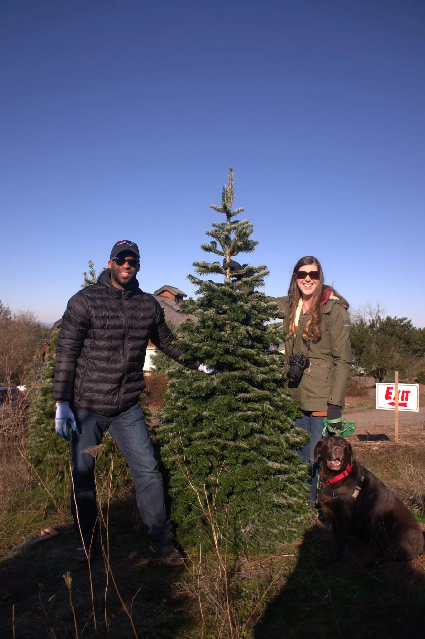 Kevin and Ashley pose by their tree