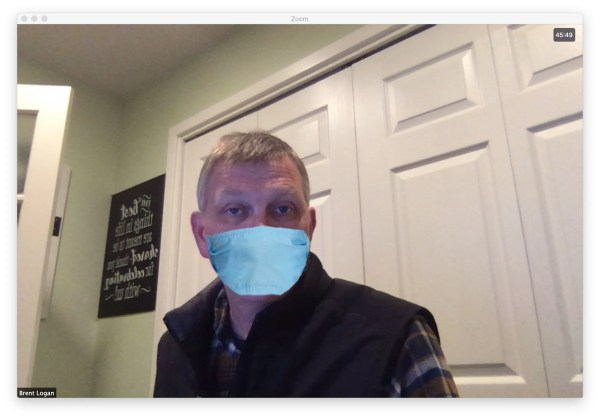 Brent wearing a surgical mask