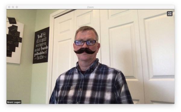 Brent wearing a mustache