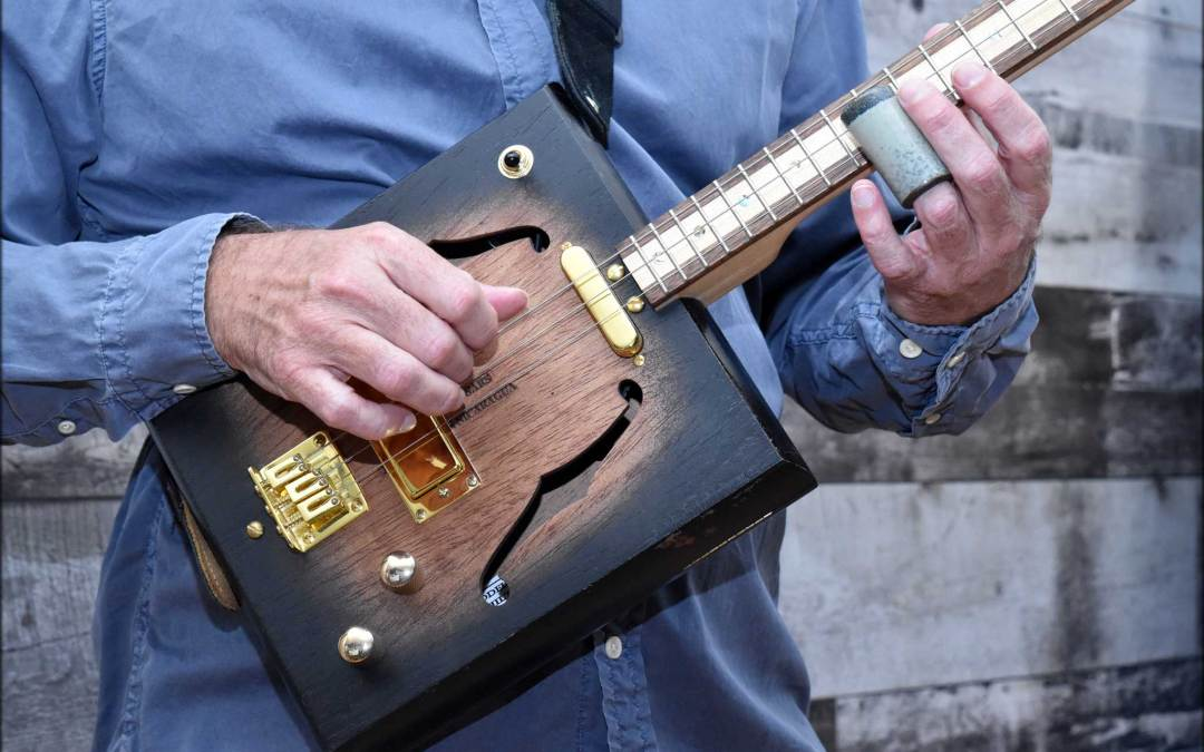 How to Play the Cigar Box Guitar