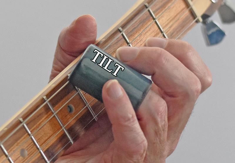 4-String--How-to-play-slide-cigar-box-guitar-slide-tilt