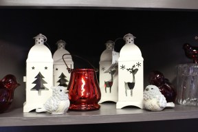 White winter and red glass birds along with Reindeer candle lanterns