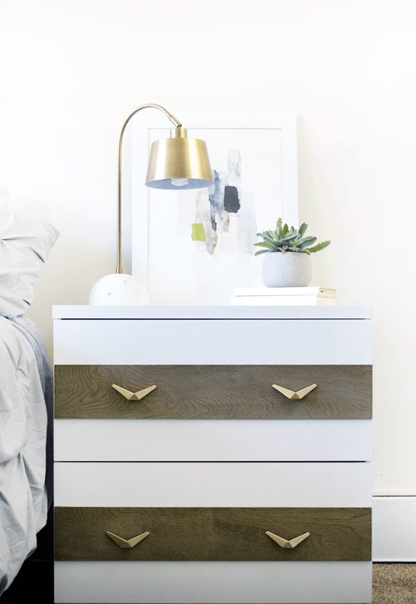Update a plain white filing cabinet by adding some weathered wood and modern, gold handles!