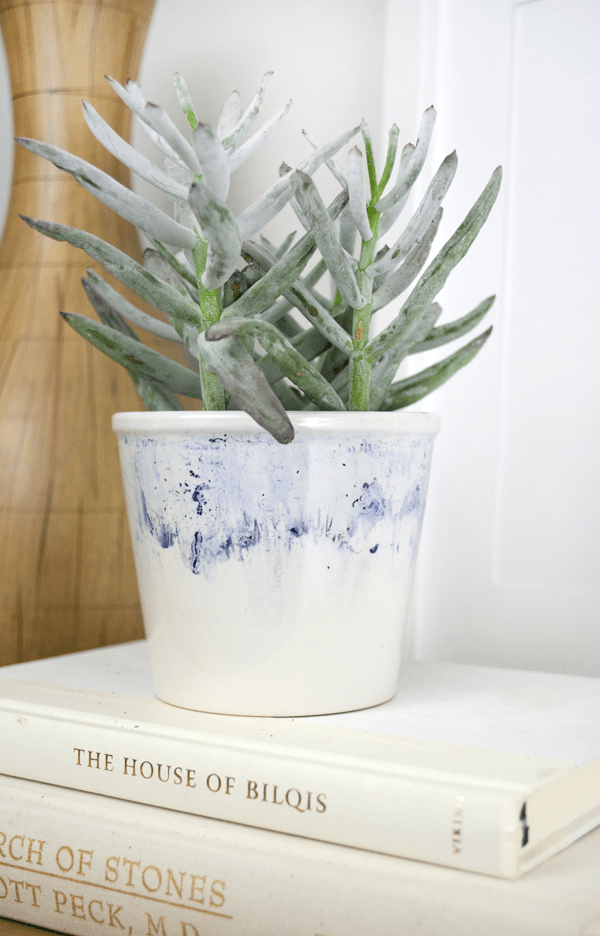 Create this DIY Watercolor Sharpie Planter using various colored sharpies and some rubbing alcohol!