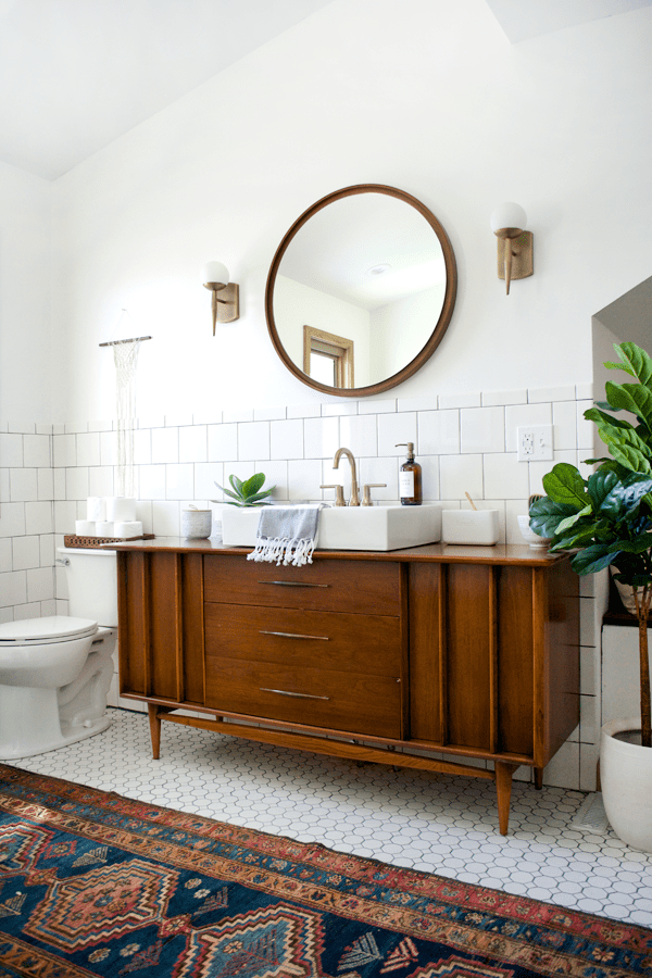 Vintage Rug And Vanity In A Modern Bathroom