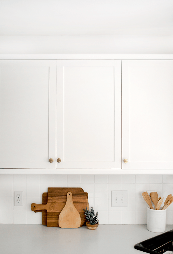 How to Add Trim and Paint Your Laminate Cabinets in Easy to Follow Steps
