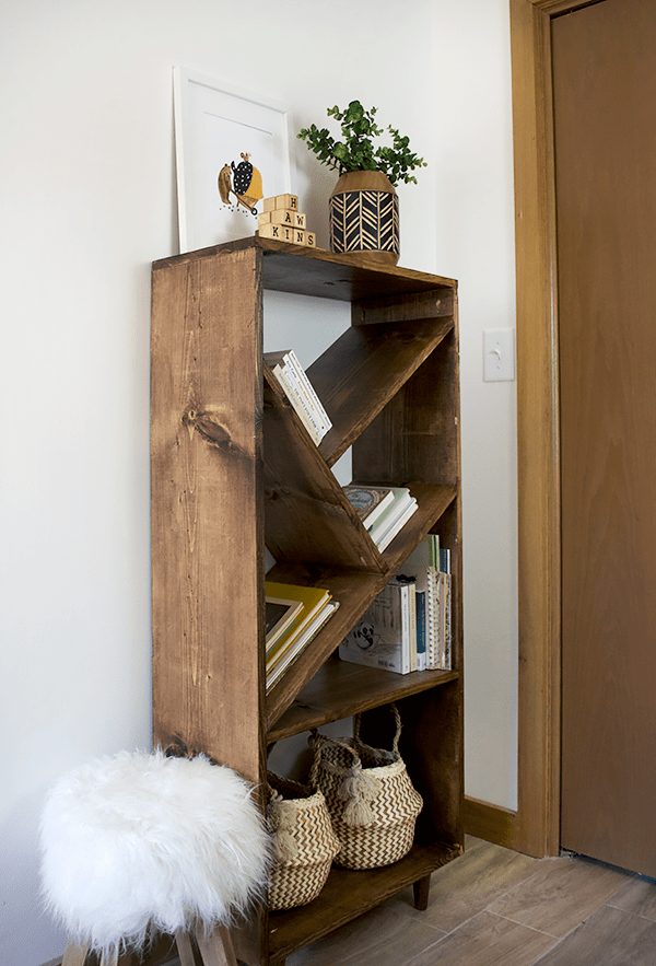 mini belly baskets on a diy bookcase with angled shelves