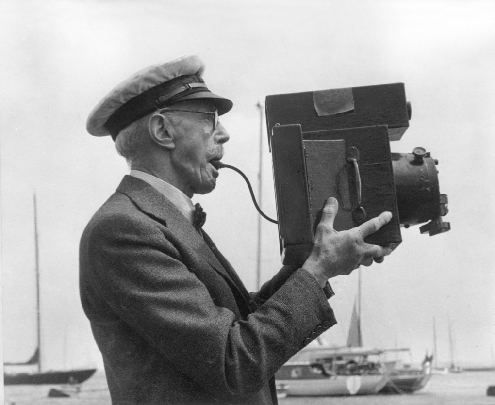 Frank Beken with his cameraTaking pictures of the yachts at Cowes. Beken of Cowes Framed Prints, Beken of Cowes archives, Beken of Cowes Prints, Beken Archive, Cowes Week old Photographs, Beken Prints, Frank beken of Cowes.