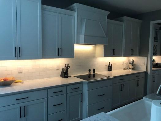 Kitchen with under cabinet lighting.