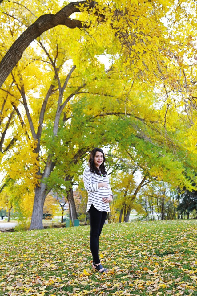 For the best bump fall photos, wear neutrals to accentuate the bump. Find bright colored trees or background to pose in front of. And pregnancy leggings are a must! | brewedtogether.com