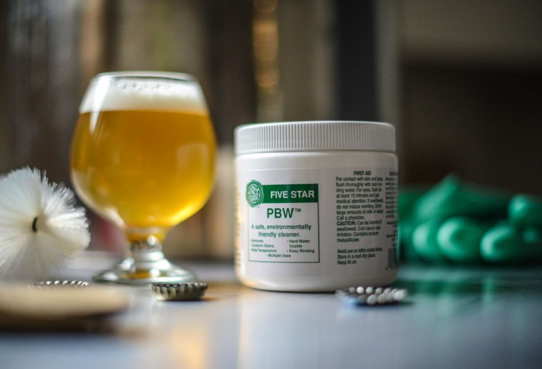 Glass of beer and Can of Brewing cleaner