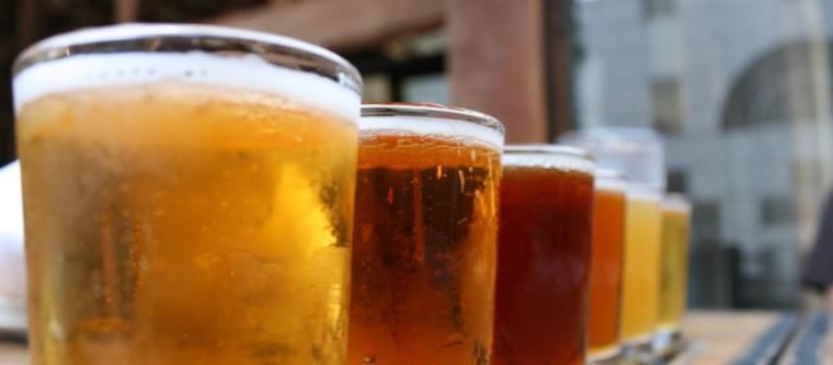 Five glasses of beer with different clarity and color