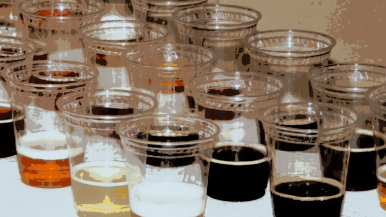 Different beer samples in plastic cups for tasting
