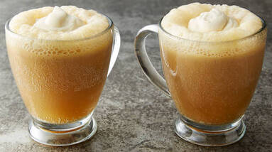 Two mugs of butter beer.