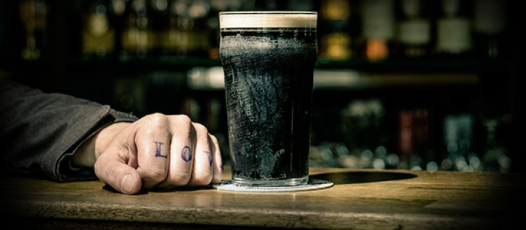 A glass of porter beer in an English pub.