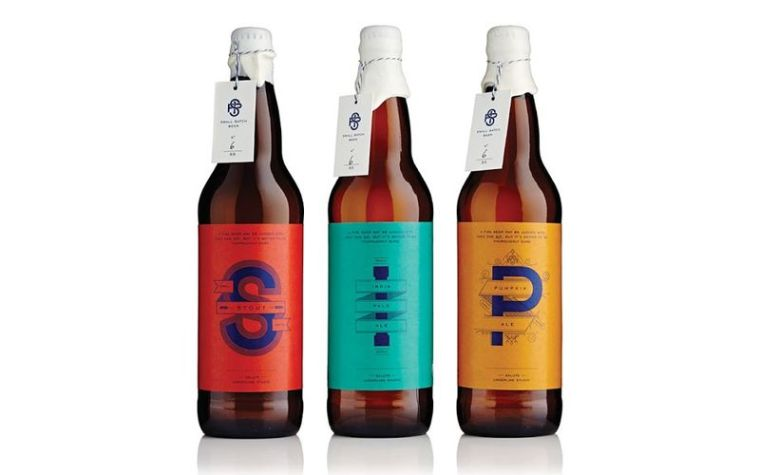 Three beer bottles with different labels and tags