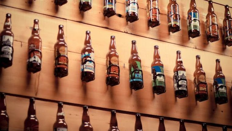 Bottles of beer displayed on the wall