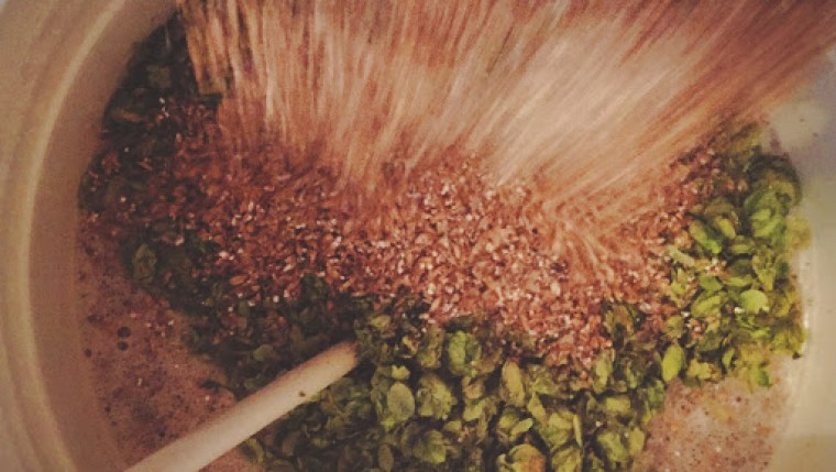 Adding hops in the mashing process of brewing beer.