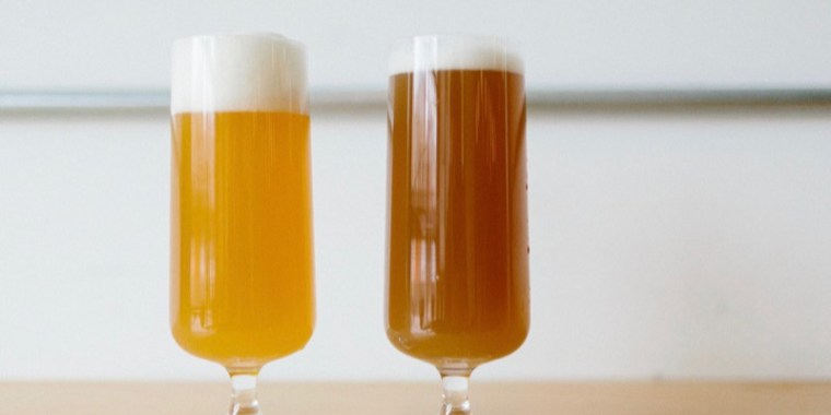 Two glasses of beer. One with the normal golden color and the other one with red brown color from oxidation.