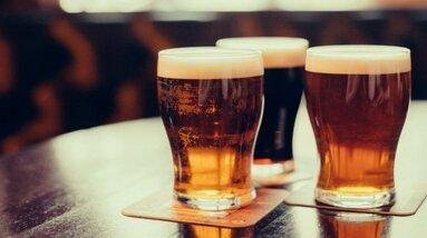 Three glasses of golden color craft beer