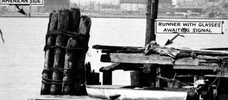 A photo of rum running operations on the Detroit river during prohibition.