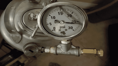 A pressure meter connected to a fermentation vessel.