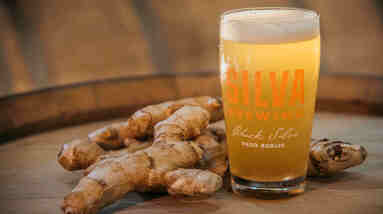 A mug of beer with ginger root.