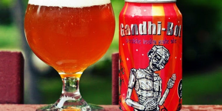 A glass and a can of Gandhi Bot IPA