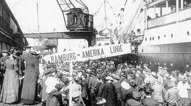 A black and white photo of German immigrants arriving at US ports.