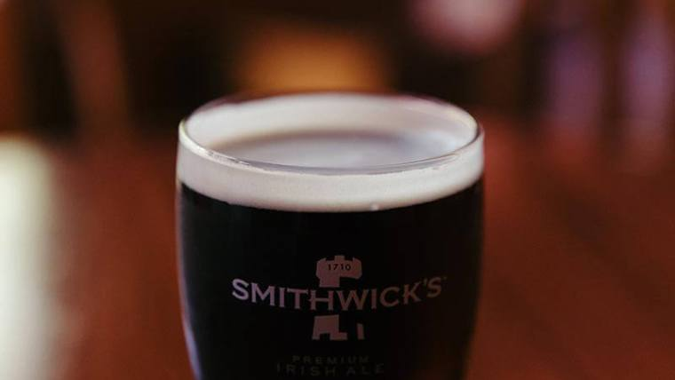 A glass of dry Irish Stout beer.