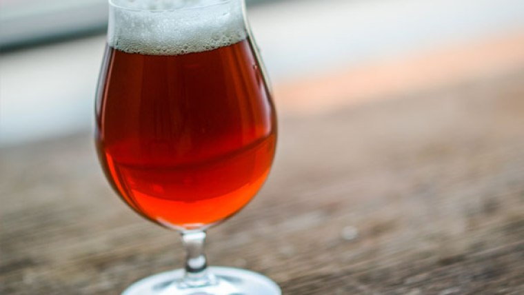 A glass of Irish red ale beer.