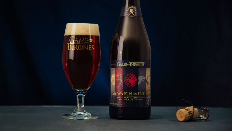 A glass of and a bottle of brown ale themed with Games of Thrones show.
