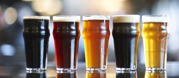 Five glasses of beer with a different beer style in each one.
