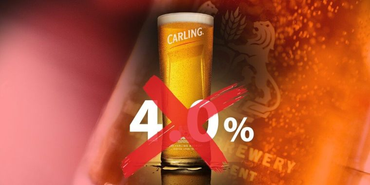 A glass of Carling beer with a red cross on it.