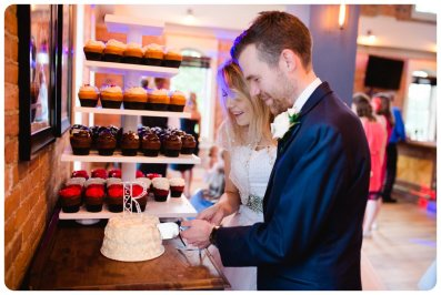 2017-06-05_0032_bride groom cutting cake_host your event_wedding venue_Brighton MI_Brewery Becker