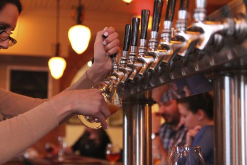 up close pouring draft beer